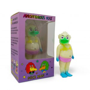 A photo of the Glow in the Dark Colorway Duck Man, standing in front of the window box