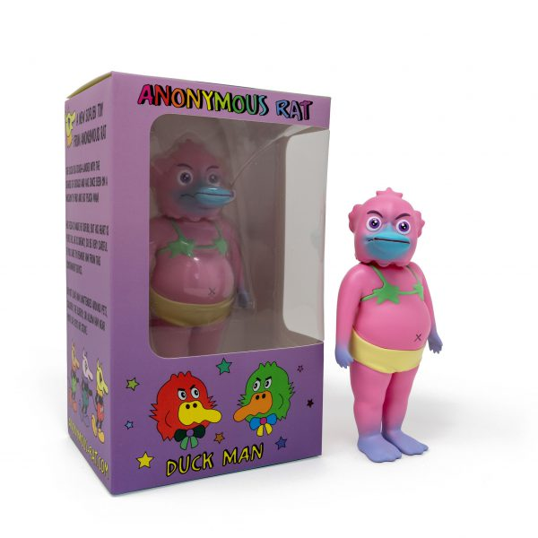 A photo of the Pink Colorway Duck Man, standing in front of the window box